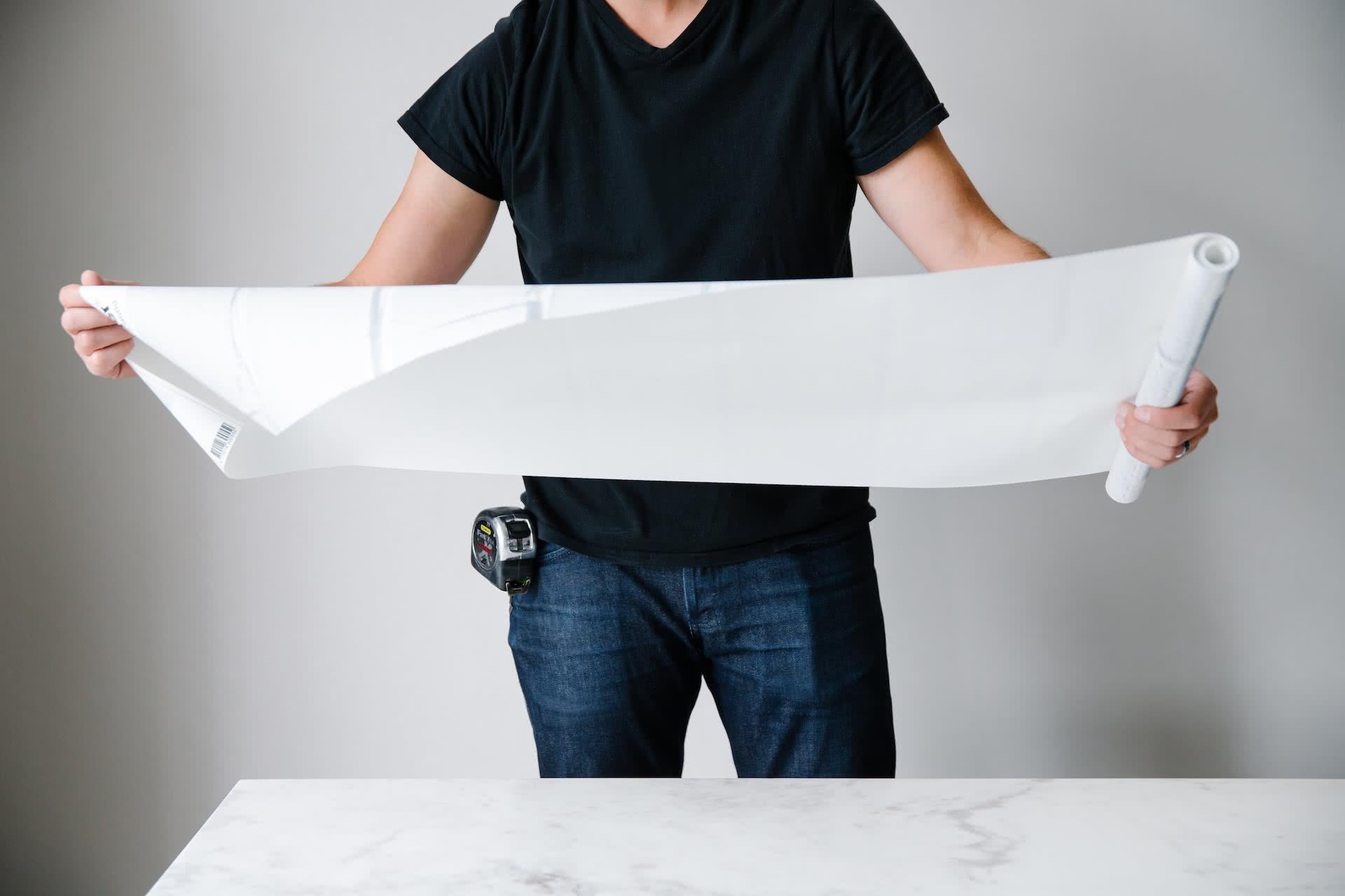 Jon Fuglestveit holding wallpaper